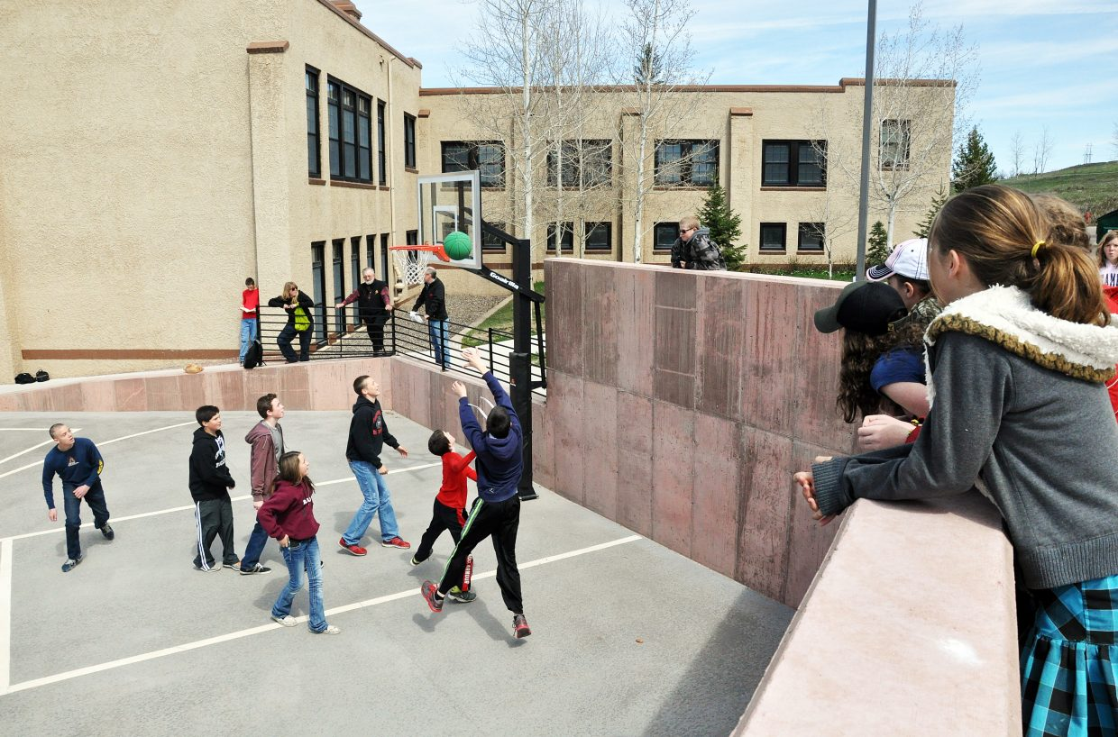 South Routt Middle School students play basketball on a new court Friday. The court and other playground improvements were completed before the start of this school year.