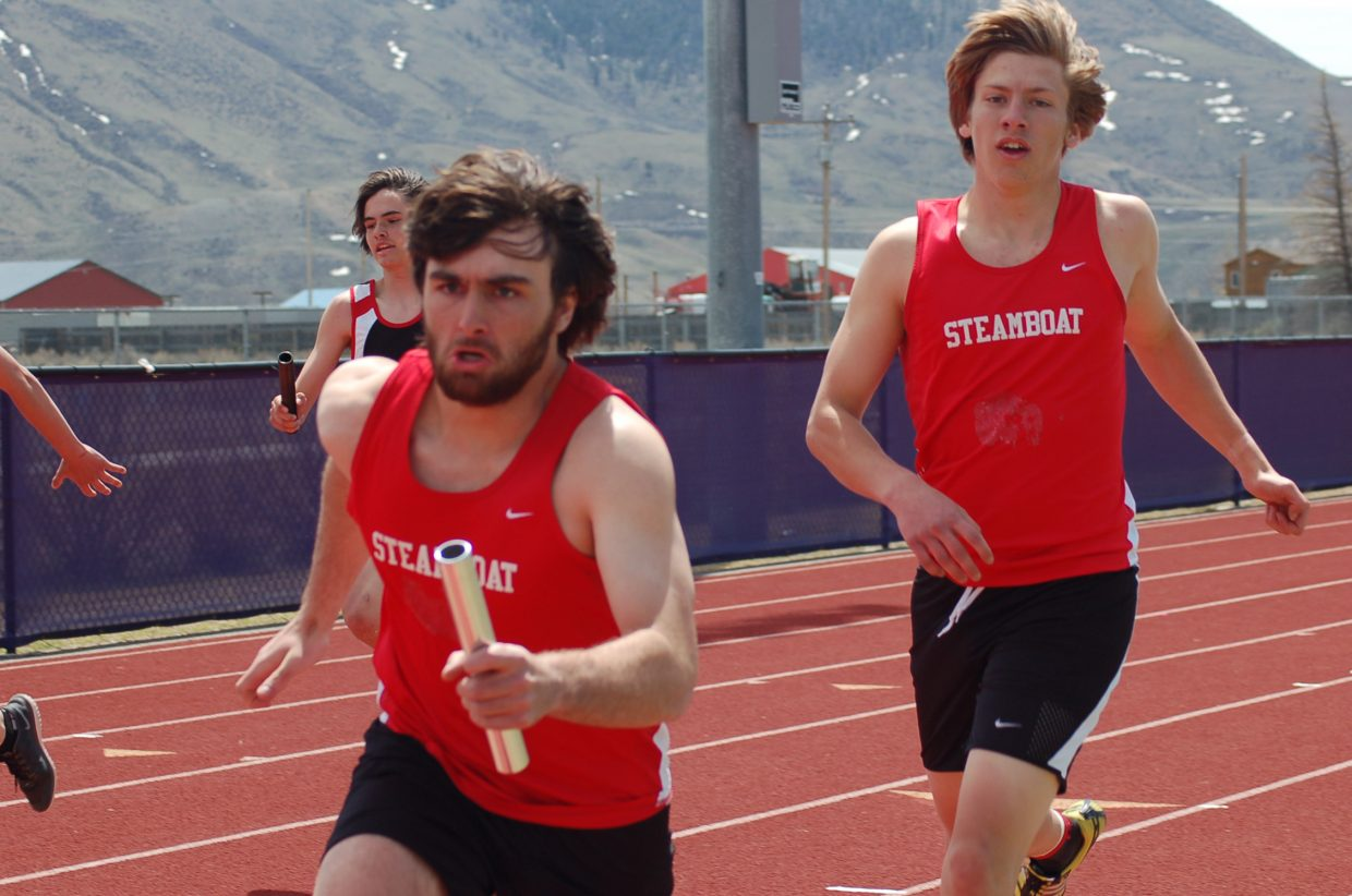 Steamboat's Dylan Wallace takes the baton from Sam Scully during the boys 800-meter relay Saturday at a track meet at West Grand High School. The team finished ninth.