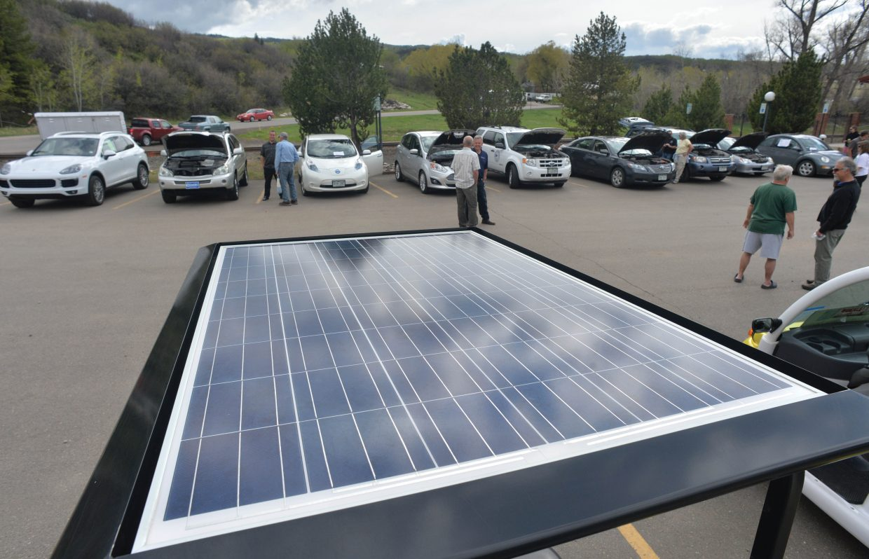 A solar panel that provides the power for Ron Famiglietti's all-terrain vehicle reflect the sky up above during the Alternative Fuels and Gas Saving Technology Expo Tuesday afternoon at the Depot Art Center. The show featured a number of different alternative and fuel saving vehicles.