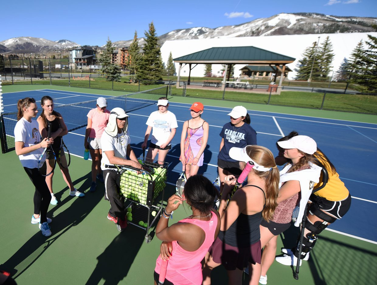 Steamboat Springs girls tennis coach John Aragon talks to his squad during practice Tuesday. The team begins play in the regional tennis tournament Thursday, hoping to win that event for the 12th-consecutive year.