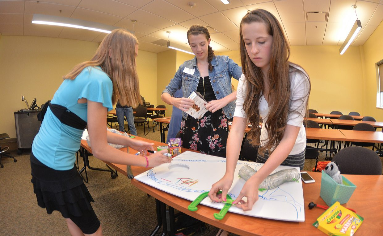 Steamboat Springs middle school students, from left to right, Nichole Mueller, Sarah Heckel and Anna Boyer design and build a golf hole during a civil engineering workshop that was part of the Eighth Grade Girls to Women Conference, which was held on the Colorado Mountain College campus Tuesday. The conference featured workshops designed to help young women become more confident before they enter high school and to expose them to paths that they may not come across in every day life.