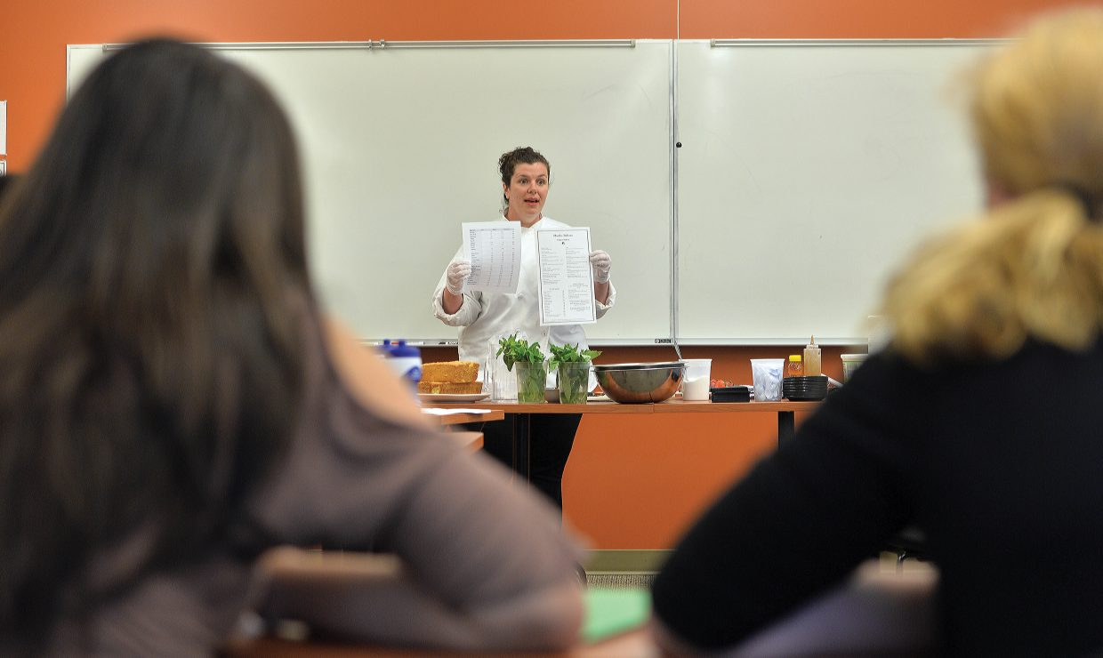 """Chef Hannah Hopkins talks to a group of eight-grade girls during a workshop titled """"be a whiz in the restaurant biz that was part of the Eighth Grade Girls to Women Conference, which was held on the Colorado Mountain College campus Tuesday. The conference featured workshops designed to help young women become more confident before they enter high school and to expose them to paths that they may not come across in every day life."""