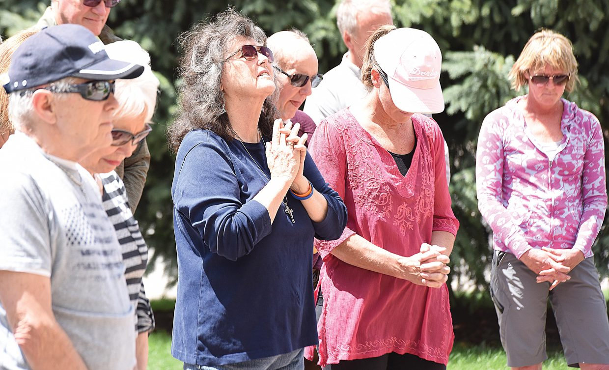 Steamboat Springs resident Jo Lauter prays on the Routt County courthouse lawn Thursday during the National Day of Prayer, an annual day of observance held on the first Thursday of May.