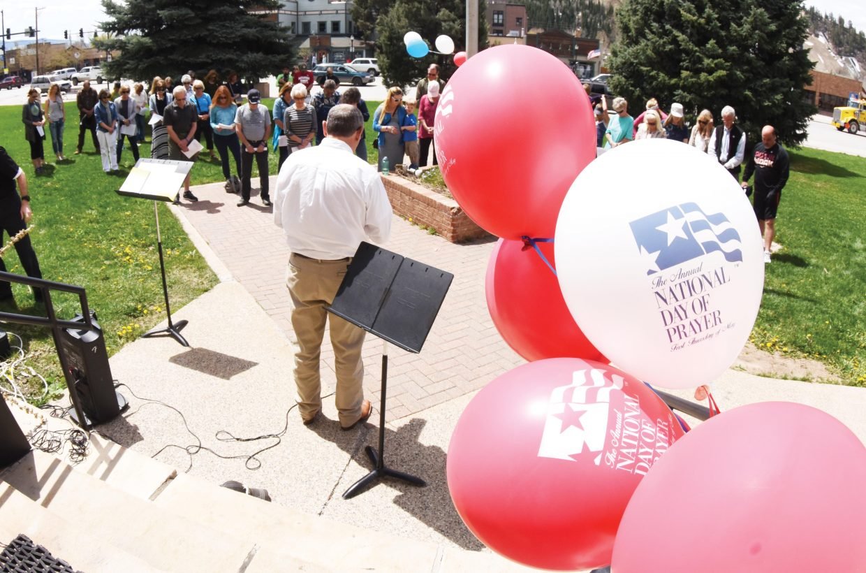 Del Lockhart helps lead a lunchtime recognition of the Day of Prayer in Steamboat Springs Thursday.