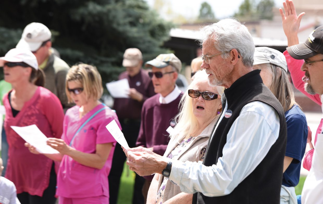 Steamboat Springs resident Al Luce sings a song during the National Day Of Pray observance on the courthouse lawn Thursday afternoon in Steamboat.