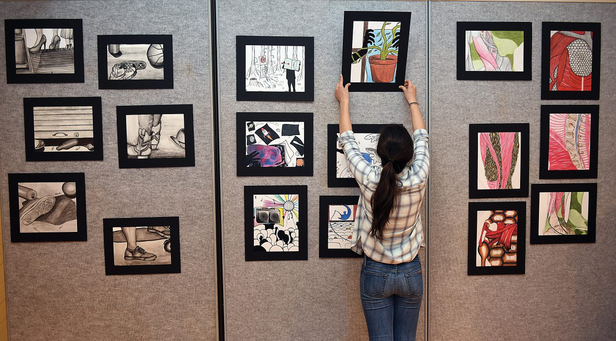 Steamboat Springs is one step closer in the pursuit of becoming a designated Colorado Creative District this week after being selected by the Colorado Creative Industries as one of the eight finalists. (In this photo:Steamboat Springs arts student Ami Constantini hangs her drawings at the Depot Art Center).