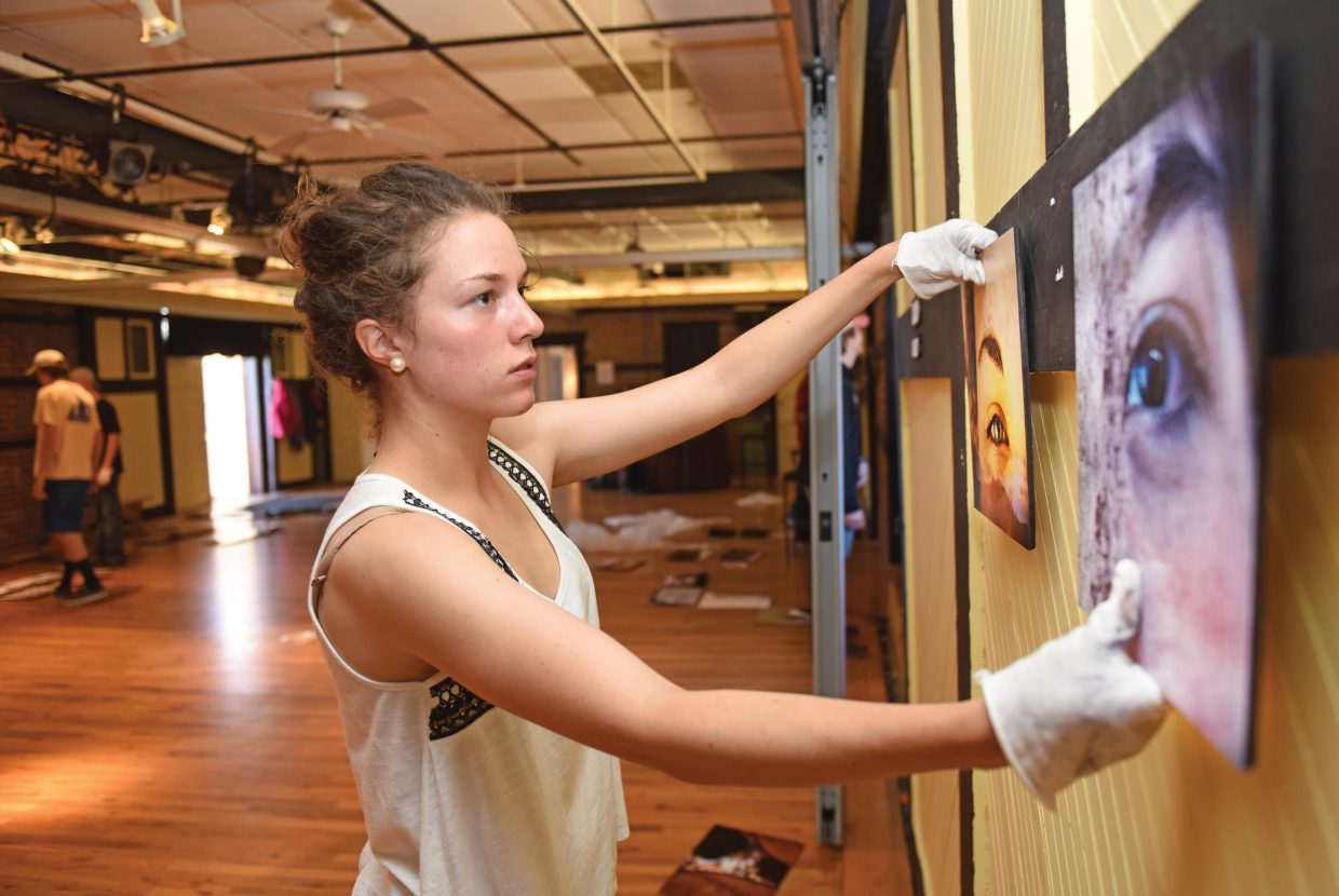 Steamboat Springs art student Meg Anderson adjusts one of her drawings on display at the Depot Arts Center Wednesday afternoon.