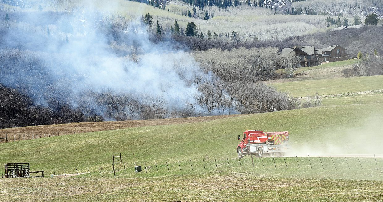 A fire truck from Steamboat Springs Fire Rescue heads to an area near Thorpe Mountain south of Steamboat where a controlled burn grew out of control Thursday afternoon. Crews from Steamboat and Oak Creek were able to knock the five-acre fire down before it became a threat to nearby homes.