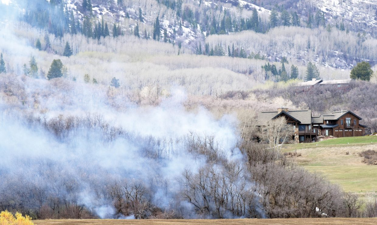 Sage brush near Thorpe Mountain smokes after a controlled burn in the area got out of control. Crews from Steamboat Springs Fire Rescue and Oak Creek responded and put the fire out before it became a threat to several nearby homes.