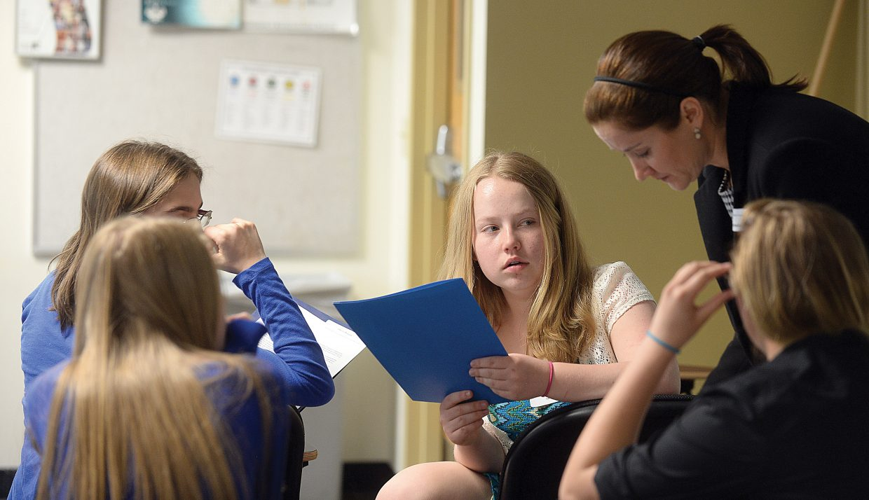 """Steamboat Springs Middle School student Kelsey Armstrong listens as attorney Lynaia South discusses a case with students during a session titled """"The Pursuit of Justice"""" at this year's Girls to Women conference at Colorado Mountain College."""