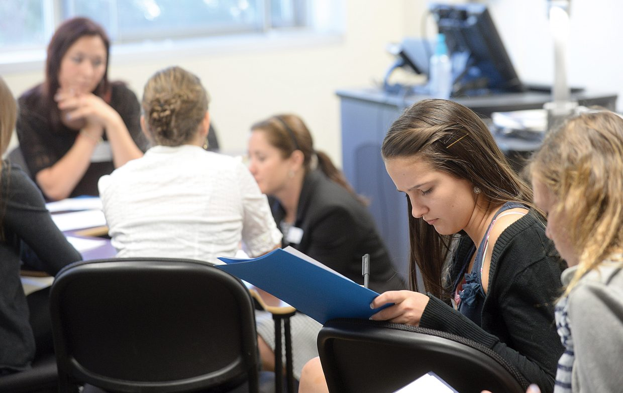 """Steamboat Springs Middle School student Lily Idzahl works on a presentation during a session titled """"The Pursuit of Justice"""" at this year's Girls to Women conference at Colorado Mountain College."""