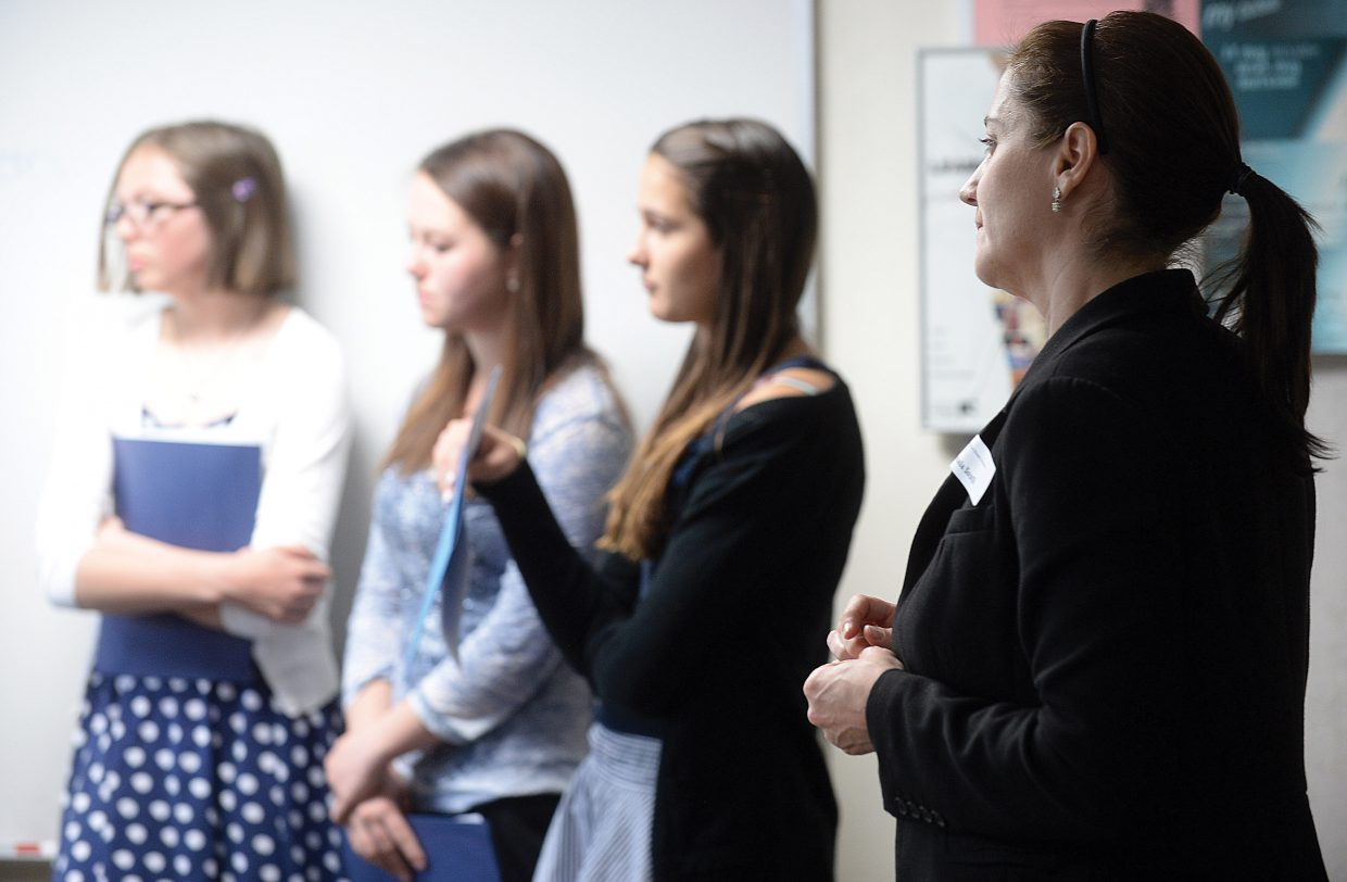 """Attorney Lynaia South listens as eighth-grade girls from Routt and Moffat counties present their cases Tuesday morning during the annual Girls to Women conference. South led a session called """"The Pursuit of Justice."""""""