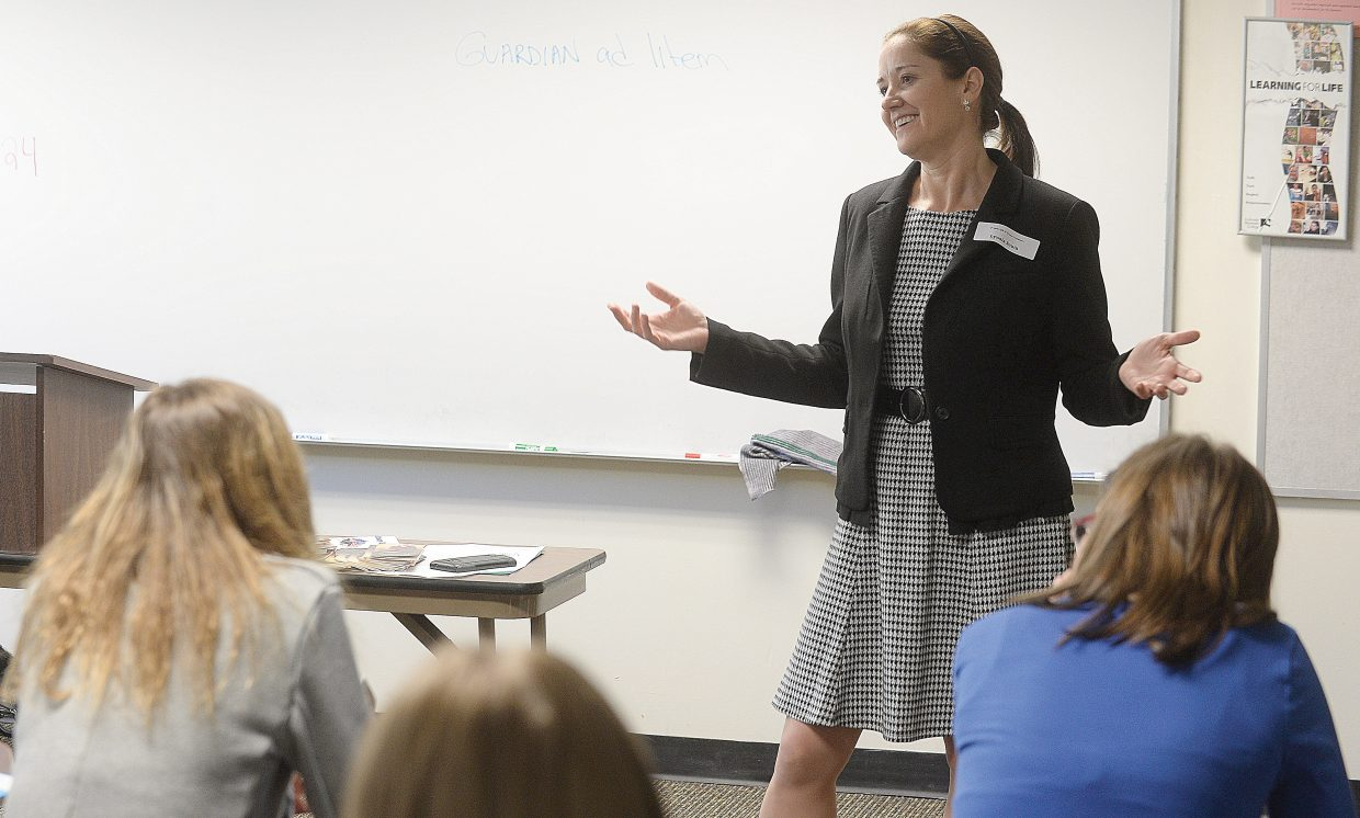 """Attorney Lynaia South talks to eighth-grade girls from Routt and Moffat counties Tuesday morning during the annual Girls to Women conference. South led a session called """"The Pursuit of Justice""""."""