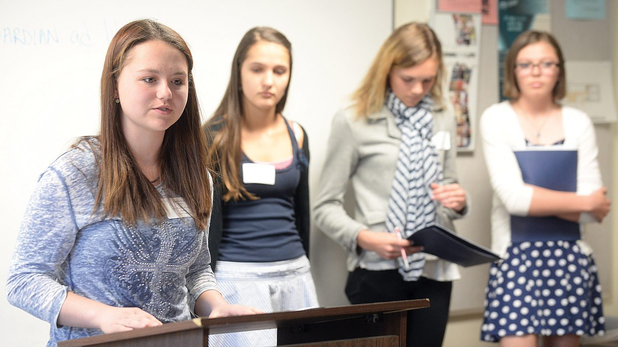 """Moffat County eighth-grader Caitlin Reed speaks during """"The Pursuit of Justice"""" workshop at this year's Girls to Women conference, which was held at Colorado Mountain College on Tuesday. The annual workshop highlights successful women in our community whom young girls can look to as role models."""