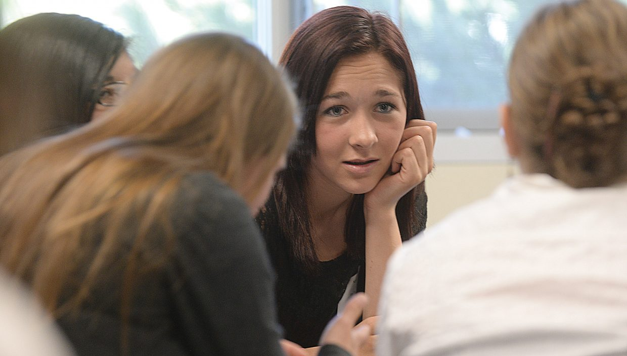 """Hayden Middle School student Kyra Bennett discusses the issues in a legal case with fellow students during a session titled """"The Pursuit of Justice"""" at this year's Girls to Women conference at Colorado Mountain College."""