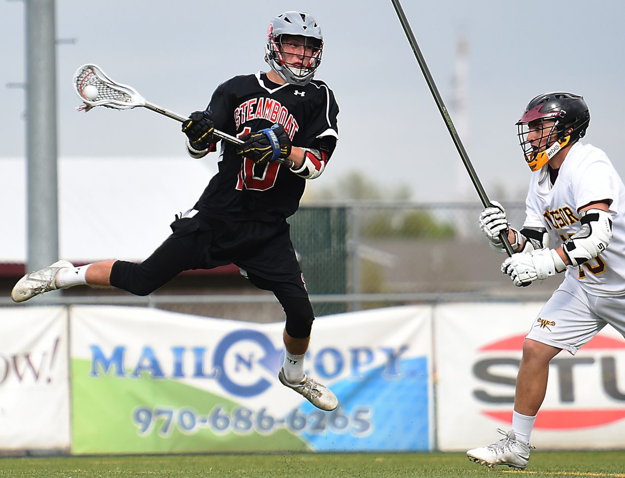 Jackson Draper rises up to let off a shot Wednesday in the state lacrosse playoffs.
