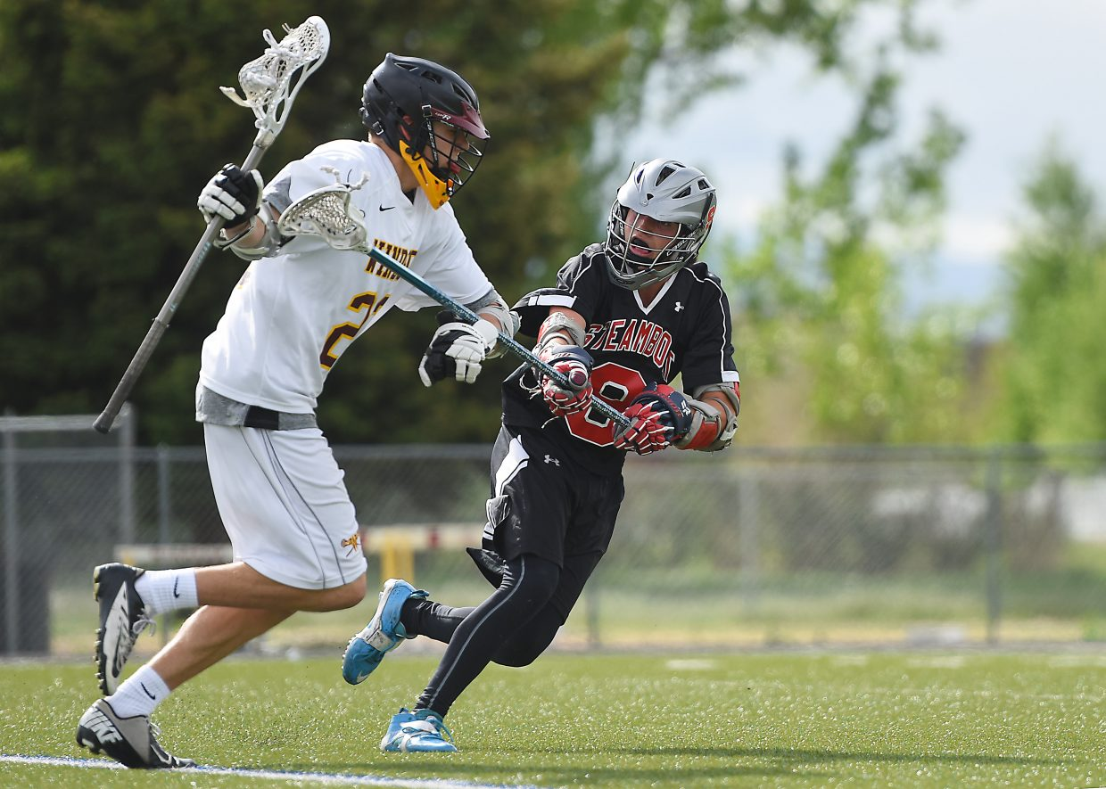 Steamboat's Sam Rossman reaches for the ball during Wednesday's state lacrosse playoffs.