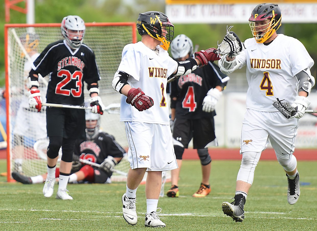 Windsor's Joe Shermock, left, and Hunter Hop celebrate a second-half goal Wednesday. The Steamboat Springs High School boys lacrosse team bounced back from a six-goal deficit and had a chance to tie the game in the waning seconds, but the Wizards came away with the win in the first round of the state playoffs, 16-15.