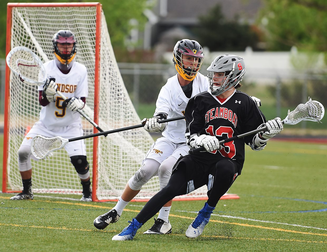 Steamboat's Willy Gunn tries to get to the goal Wednesday during the lacrosse state playoffs in Windsor.