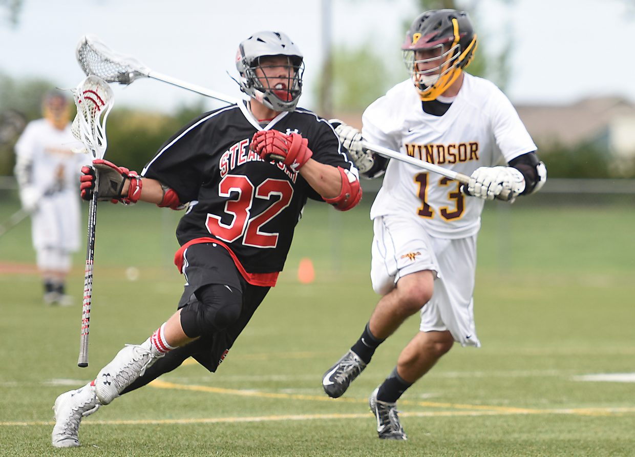 Steamboat's Mitch McCannon moves the ball up the field Wednesday during the lacrosse state playoffs.