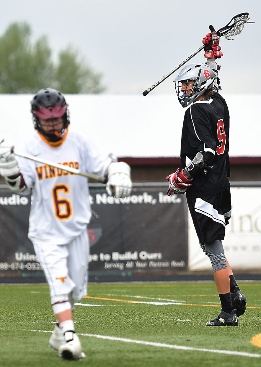 Steamboat's Andrew Firestone celebrates a goal Wednesday during the lacrosse state playoffs in Windsor.