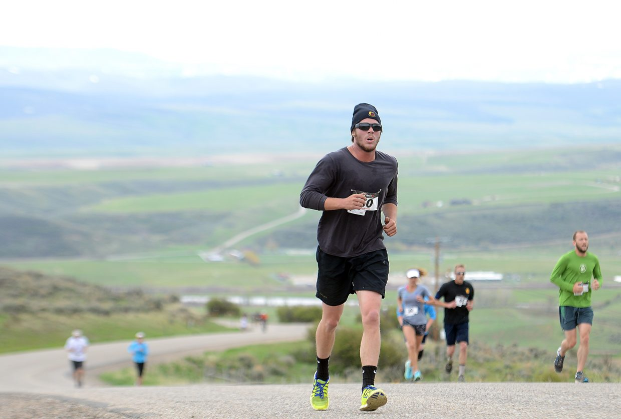 Luke Schutte runs up the Cog Road during the 2014 Hayden Cog Run. The race returns this weekend with a 10 a.m. Saturday start.