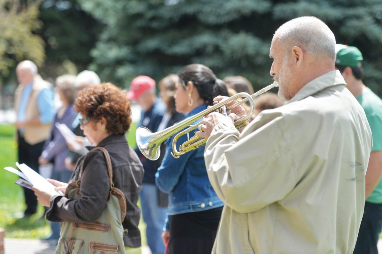 Ray Zimpher plays the trumpet while taking part in the National Day of Prayer on the Routt County Courthouse lawn in Steamboat Springs Thursday. Events recognizing the National Day of Prayer take place in cities across the United States on the first Thursday of May.