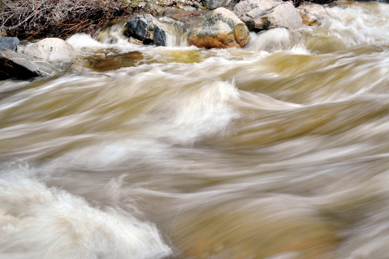 Water rushes down Fish Creek Thursday en route to the Yampa River.