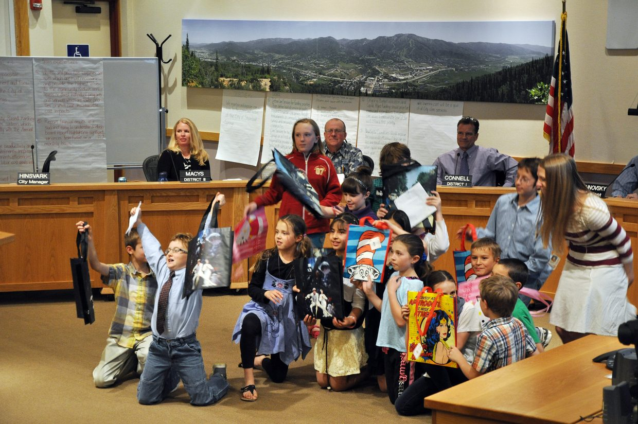 Strawberry Park Elementary School students show off their reusable bags Tuesday at the Steamboat Springs City Council meeting. The students asked the city council to address the use of plastic bags.