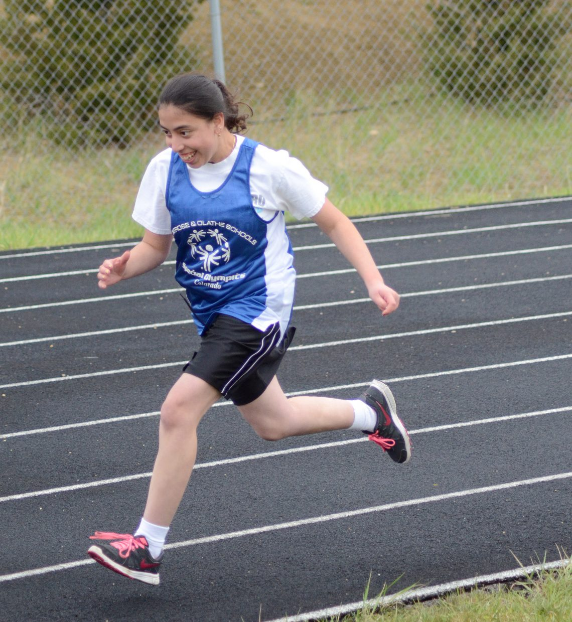 Carolina Jaramillo sprints out at the start of her 400 meter run, where she won a gold medal in Craig Saturday.