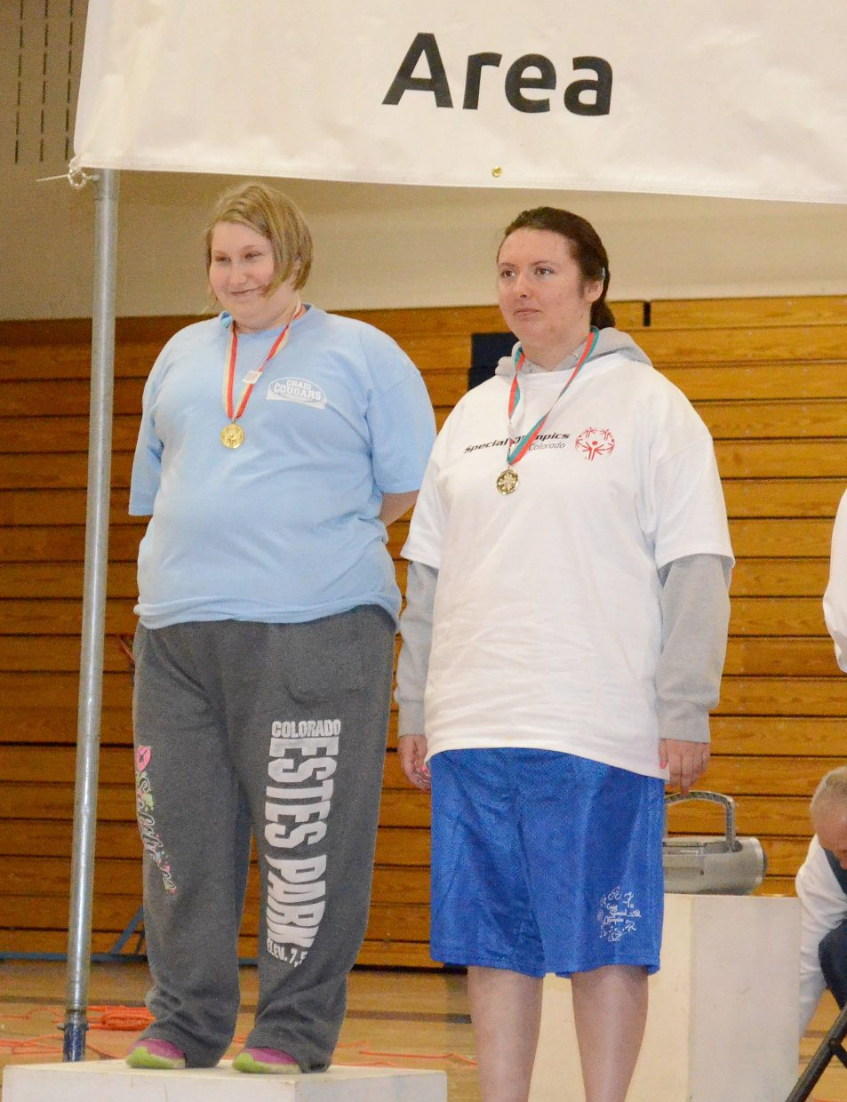 Alison Douglas (left) and Emily Tunks were teammates on the Craig four by 100 relay team and took first and second in the softball throw as well.