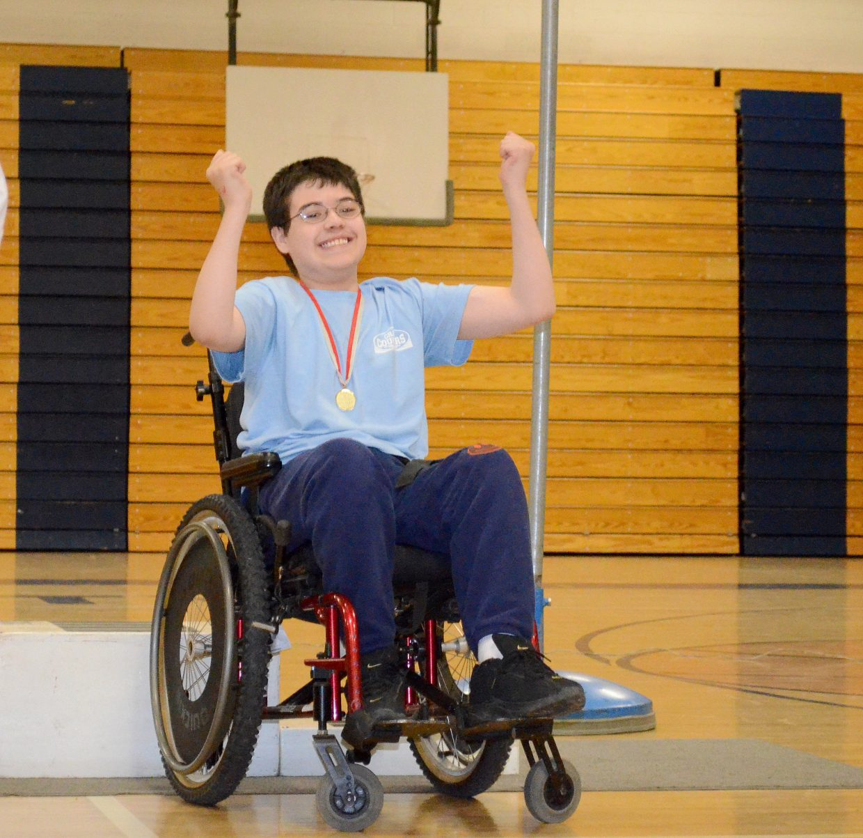William Johnson celebrates receiving a medal during at the Western Area Summer Games.