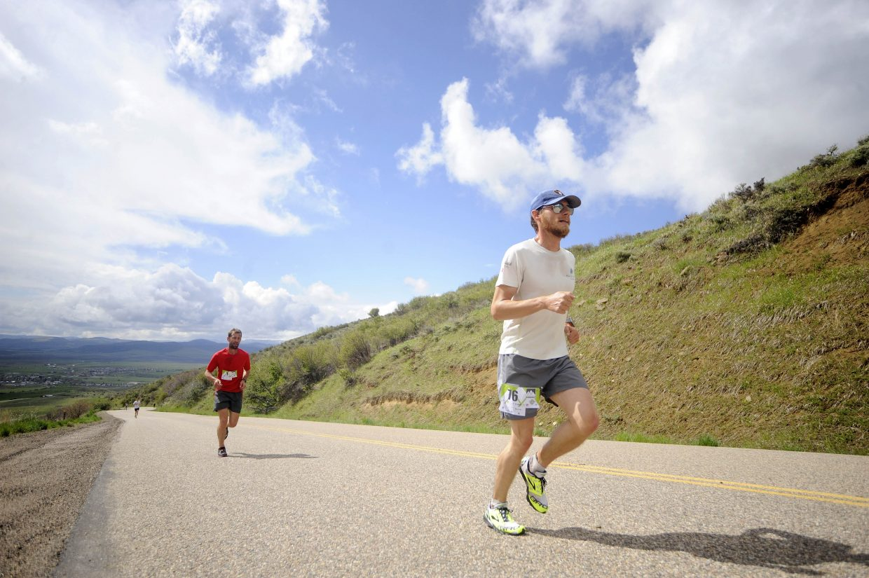 Steamboat Springs runner Jesse Wilkins leads the charge up Routt County Road 76 on Saturday during the Hayden Cog Run. Wilkins won the mens division with a time of 51 minutes, 55 seconds.