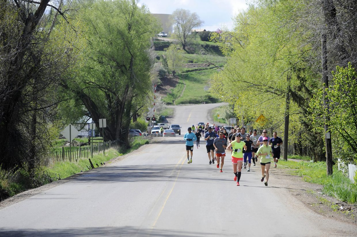 Runners head up to the Cog on Saturday during the Hayden Cog Run.
