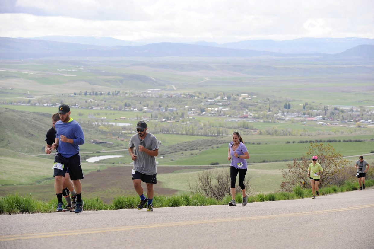 Runners head up the Cog on Saturday during the Hayden Cog Run.