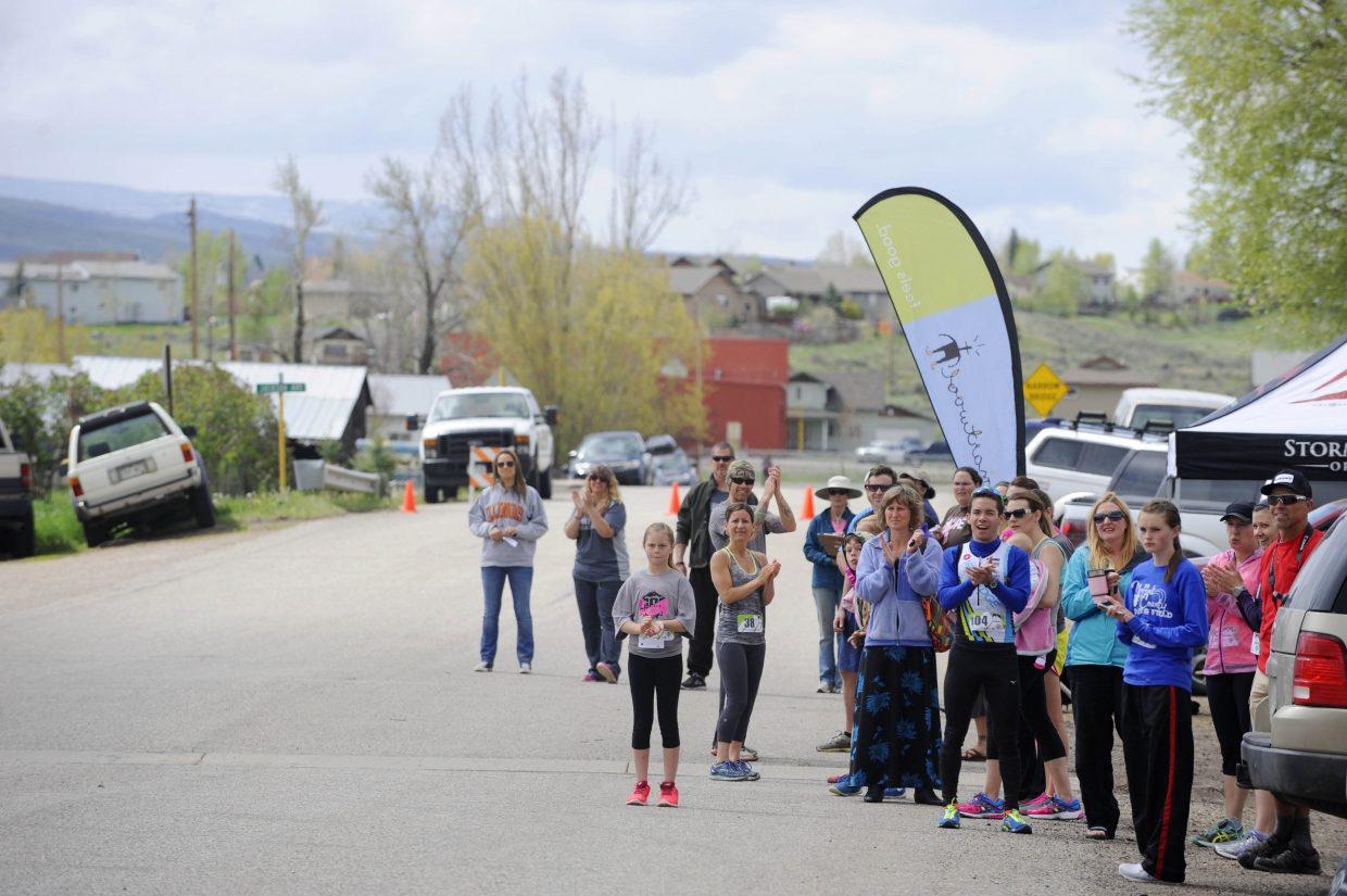 A crowd cheers on finishers Saturday during the Hayden Cog Run.