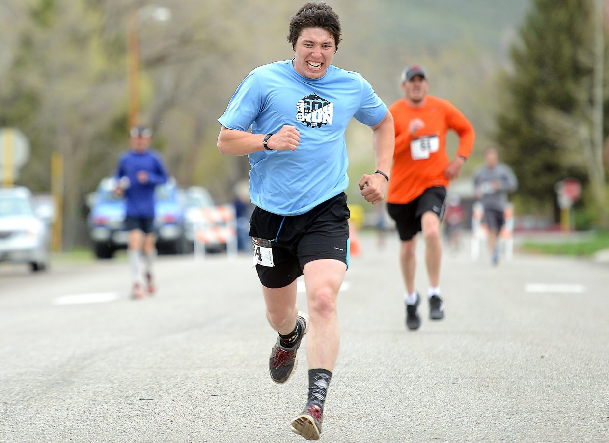 Aaron Ballesteros sprints to the finish line Saturday at the Hayden Cog Run.
