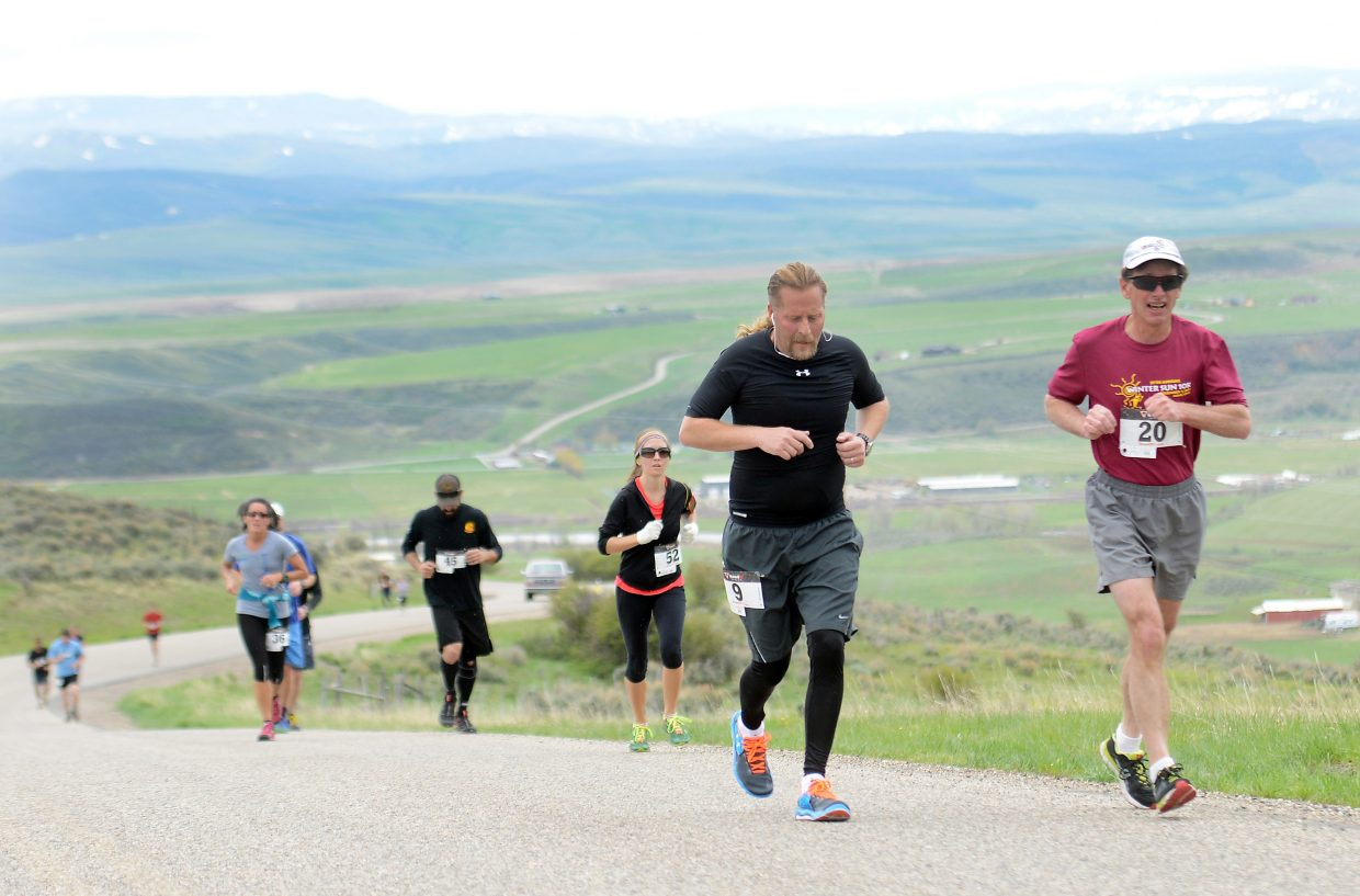 Jonah Drescher, left, and James Morton lead a pack of runners up the Cog Road outside Hayden on Saturday. The annual race drew more than 100 runners.