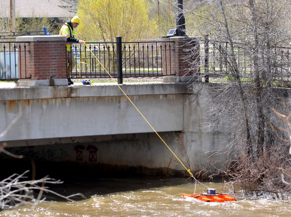 Jeff Foster of the the USGS launched a high-tech streamflow measuring device called an Acoustic Doppler Current Profiler into the Yampa River at Fifth Street to make precise measurements of the river's flows.