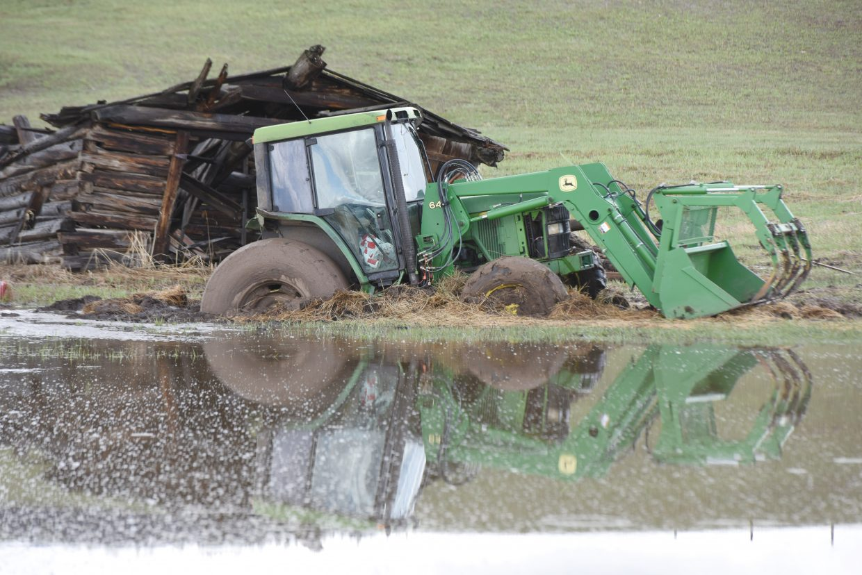 This tractor, which appears to be stuck in the mud in a pasture along Routt County Road 14 south of Steamboat Springs, is a testament to how wet this spring has been in the Yampa Valley.