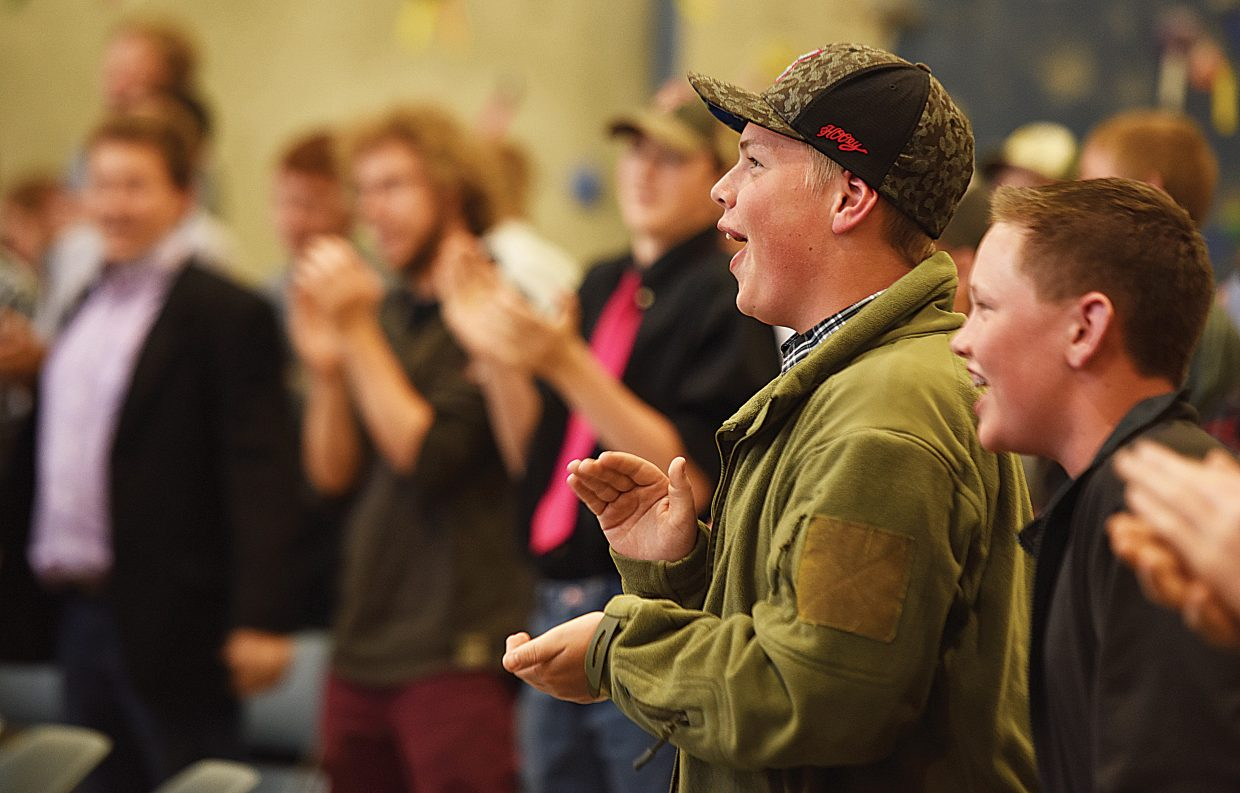 North Park eighth grader Del Garner applauds during Todd Musselman's presentation at this year's The Journey Ahead presentation Tuesday at Colorado Mountain College in Steamboat Springs. The boys conference was held in conjunction with the Girls to Women Conference.