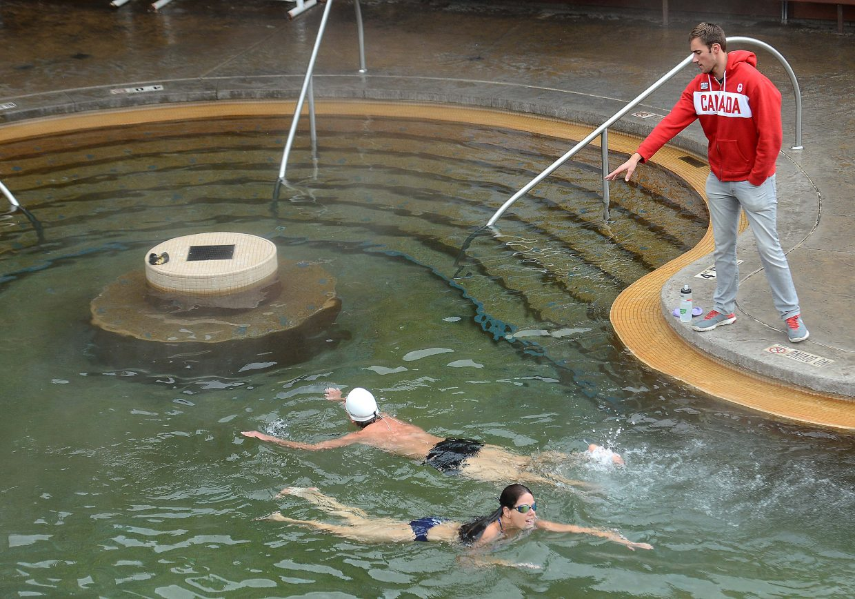 Blake Worsley offers a tip to a swimmer during a Thursday clinic at Old Town Hot Springs in downtown Steamboat Springs. The Steamboat-raised swimmer competed in the 2012 Summer Olympics for Canada and retired during the winter.