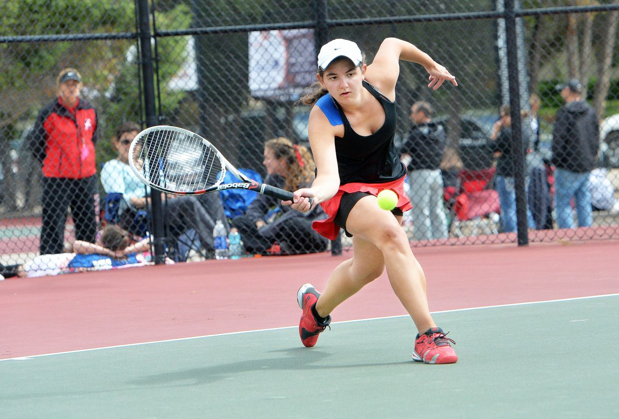 Steamboat Springs No. 3 singles player Emmie Thompson returns a shot during the first day of the Colorado State High School Tennis tournament in Pueblo.