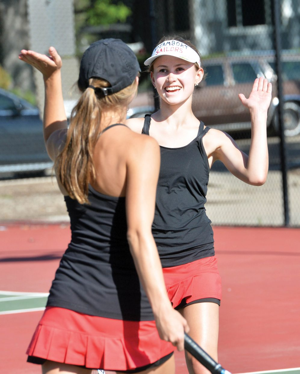 Steamboat's No. 2 doubles players Sydney Boyd and Sabina Berend exchange a high five during the first day of the Colorado 4A State High School Tennis Championships at Pueblo City Park. The team won its opening round match but fell in the semifinals.