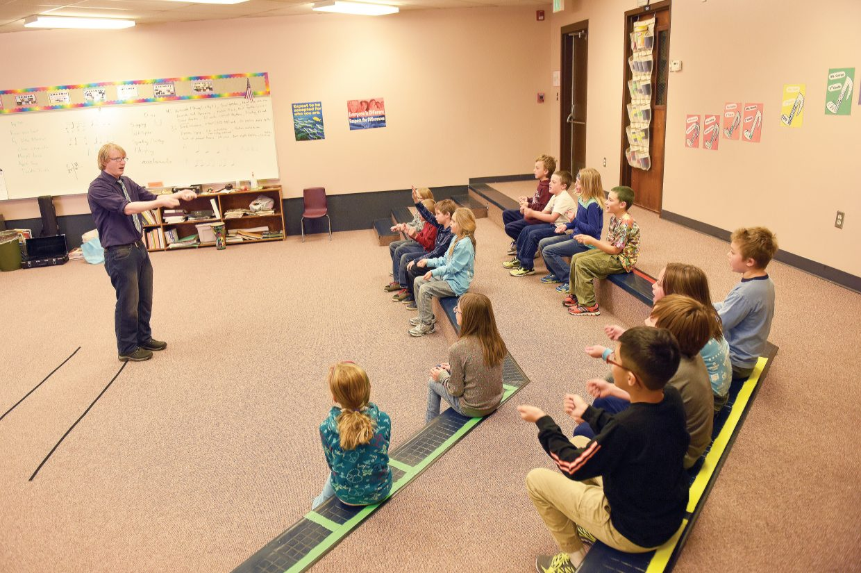 Fourth-grade students listen during a music class at South Routt Elementary in November.
