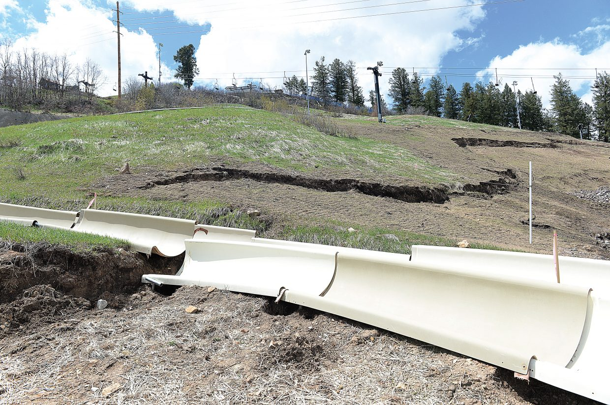 A head scarp from a recent landslide can be seen cutting across the face of Howelsen Hill. For the second year in a row, the slide threatens lights, lift towers and the Alpine slide. Anticipating further movement on the hill, the Steamboat Springs Winter Sports Club proactively took sections of the slide apart.
