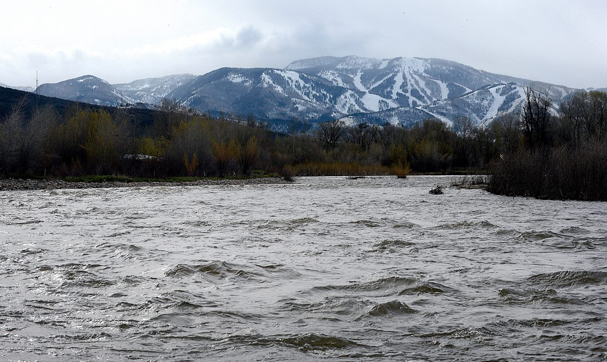 The waters of the Yampa River already are flowing bank to bank, and the new snow at the top of Steamboat Ski Area on Monday morning only will help increase the flow in the next few days.
