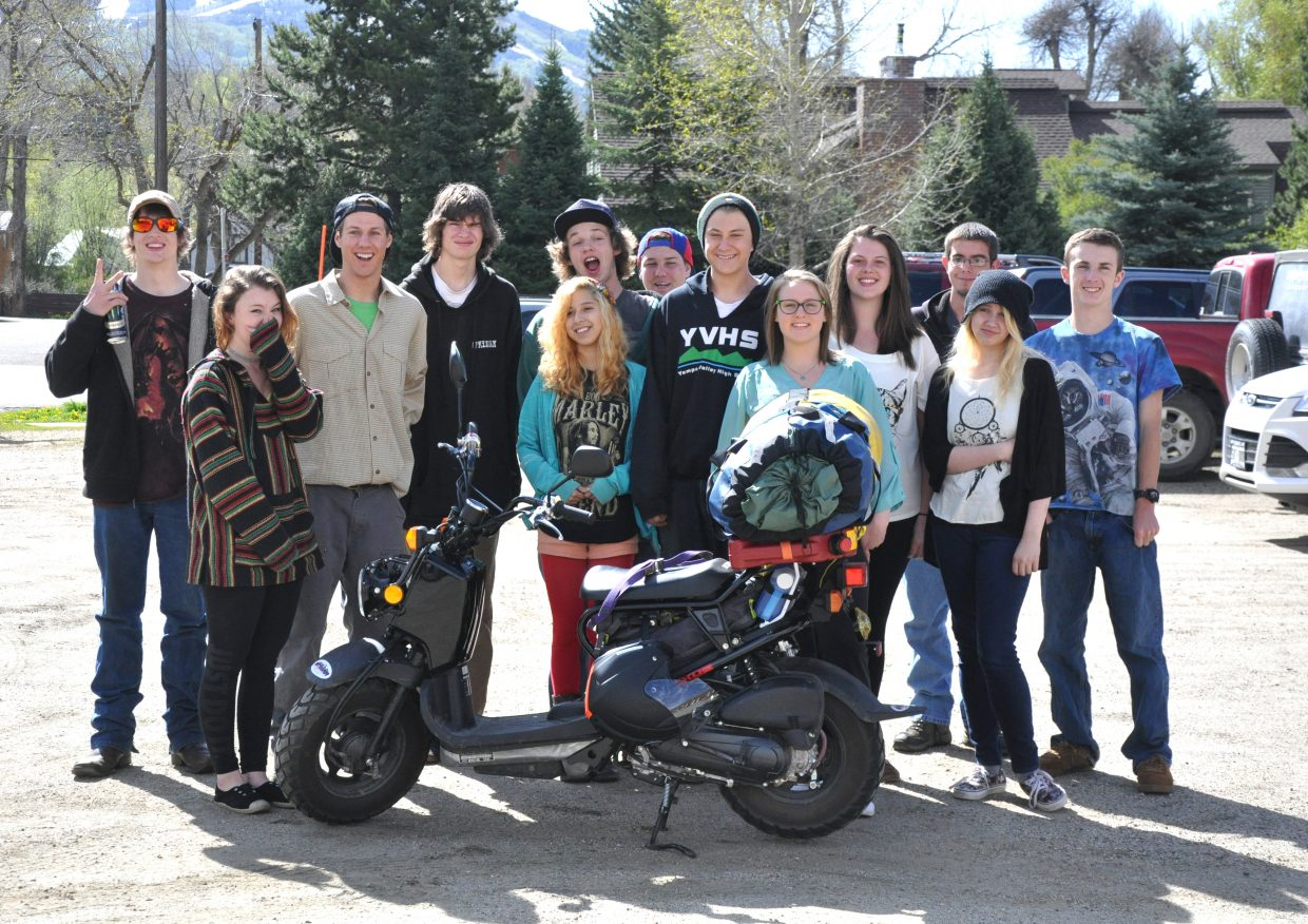 Robert Shearon, third from left, poses with Yampa Valley High School students on Tuesday afternoon prior to the start of his 4,600-mile scooter ride from Colorado to Alaska.