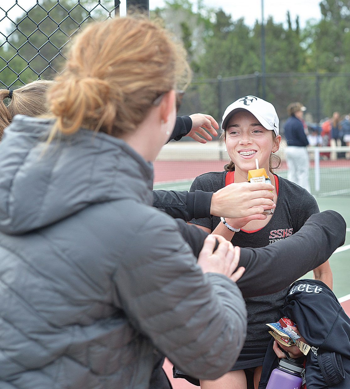 Steamboat Springs No. 1 singles player Tatum Burger is greeted by teammates as she steps off the courts at Pueblo City Park on Tuesday. Burger defeated Cheyenne Mountain senior Payton Fielding to earn a shot at a state title Wednesday in a match with St. Mary'sAcademy senior Alex Weil.