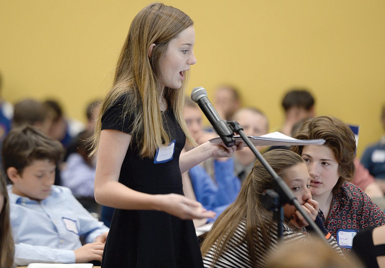 Morgan Graham listens to a speaker during the Model United Nations event on the Colorado Mountain College campus Thursday. Middle school students from Craig, Steamboat Springs, South Routt, Walden, Granby, Fort Collins, Aspen and Eagle/Vail came for the event, which simulates the decision making process of the real United Nations.